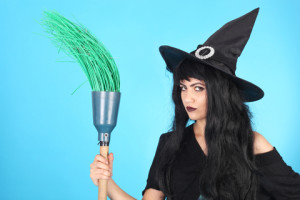 A mean witch with a broomstick!