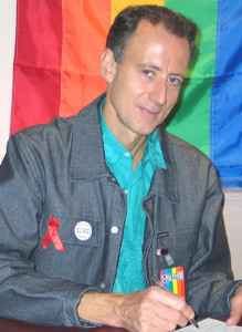 Peter Tatchell surrounded by bright colours